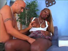 Playful black tranny fucking with bald guy on sofa
