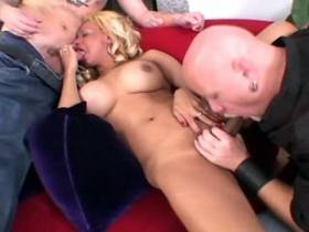 Two guys wildly fuck eager ethnic shemale on red sofa
