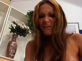 Redhead shemale with dildo fucks blond tranny on sofa